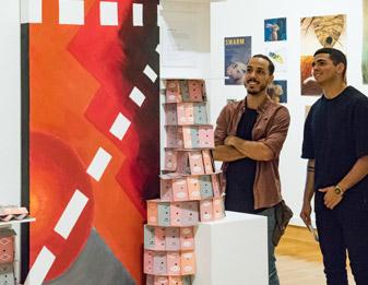 students looking at art