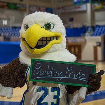 FGCU Eagle Holding Building Pride Sign