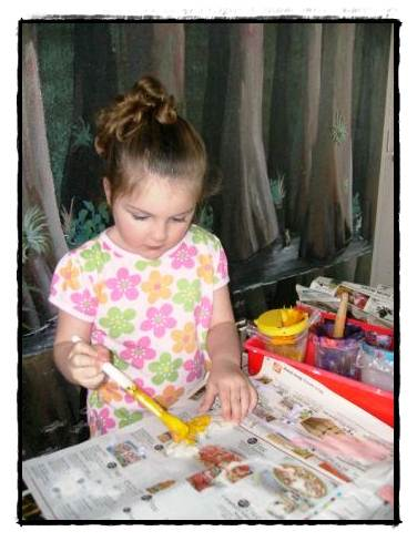 young girl painting at the FRC