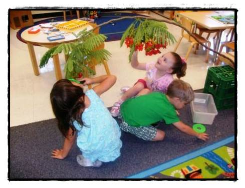 young children playing in the classroom at FRC