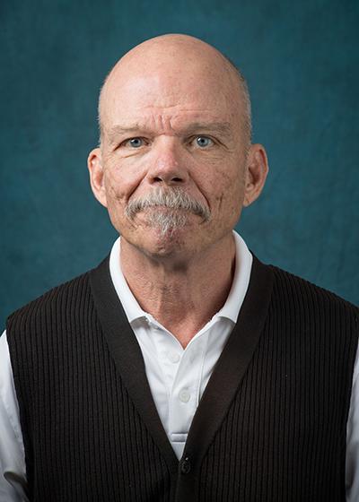 Dr. Mark Simpson