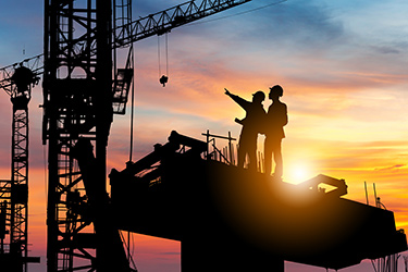 Construction crane and engineers