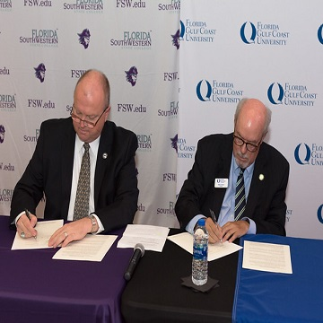 fgcu president signing document next to fsw president