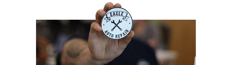 Correy Upstott showing his sticker for Eagle Auto Repair