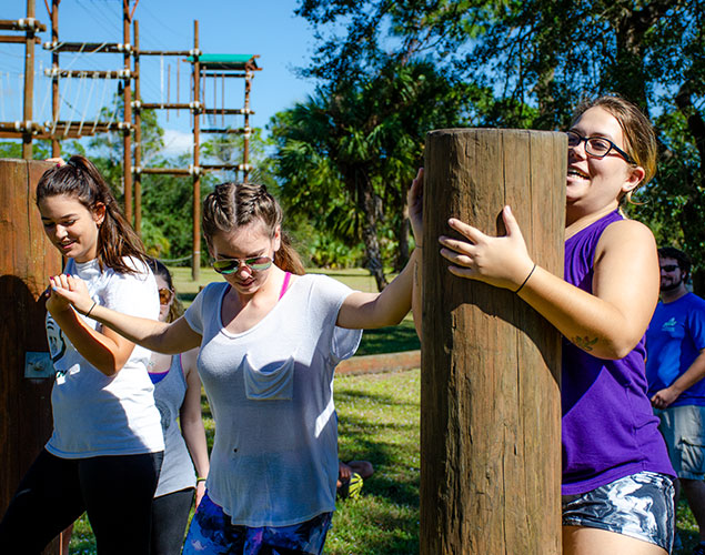 Students progessing through the Eagle Challenge Course