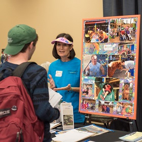 Photo of community member and student talking